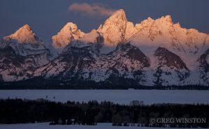 A cloud trails off the summit of the Grand Teton, Teton Range at sunrise.